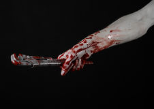 Bloody hand holding an adjustable wrench, bloody key, crazy plumber, bloody theme, halloween theme, black background,isolated Royalty Free Stock Photos