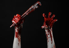 Bloody hand holding an adjustable wrench, bloody key, crazy plumber, bloody theme, halloween theme, black background,isolated Stock Images