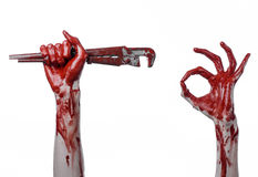 Bloody hand holding an adjustable wrench, bloody key, crazy plumber, bloody theme, halloween theme, white background,isolated Royalty Free Stock Photos