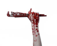 Bloody hand holding an adjustable wrench, bloody key, crazy plumber, bloody theme, halloween theme, white background,isolated Stock Photos