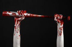 Bloody hand holding a baseball bat, a bloody baseball bat, bat, blood sport, killer, zombies, halloween theme, isolated, black bac Stock Image