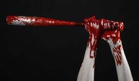 Bloody hand holding a baseball bat, a bloody baseball bat, bat, blood sport, killer, zombies, halloween theme, isolated, black bac Royalty Free Stock Photos