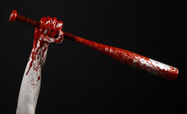 Bloody hand holding a baseball bat, a bloody baseball bat, bat, blood sport, killer, zombies, halloween theme, isolated, black bac Royalty Free Stock Image