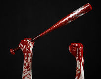 Bloody hand holding a baseball bat, a bloody baseball bat, bat, blood sport, killer, zombies, halloween theme, isolated, black bac Stock Photo