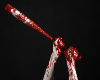 Bloody hand holding a baseball bat, a bloody baseball bat, bat, blood sport, killer, zombies, halloween theme, isolated, black bac Stock Images