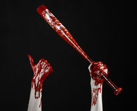 Bloody hand holding a baseball bat, a bloody baseball bat, bat, blood sport, killer, zombies, halloween theme, isolated, black bac Stock Photos