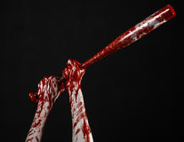 Bloody hand holding a baseball bat, a bloody baseball bat, bat, blood sport, killer, zombies, halloween theme, isolated, black bac Royalty Free Stock Photos