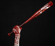 Bloody hand holding a baseball bat, a bloody baseball bat, bat, blood sport, killer, zombies, halloween theme, isolated, black bac Royalty Free Stock Photo