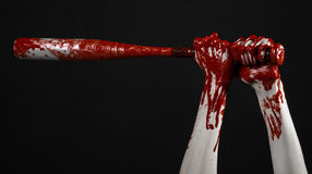 Bloody hand holding a baseball bat, a bloody baseball bat, bat, blood sport, killer, zombies, halloween theme, isolated, black bac Royalty Free Stock Photography