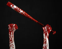 Bloody hand holding a baseball bat, a bloody baseball bat, bat, blood sport, killer, zombies, halloween theme, isolated, black bac Stock Photography