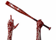 Bloody hand holding a baseball bat, a bloody baseball bat, bat, blood sport, killer, zombies, halloween theme, isolated, white bac Stock Photos