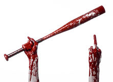 Bloody hand holding a baseball bat, a bloody baseball bat, bat, blood sport, killer, zombies, halloween theme, isolated, white bac Royalty Free Stock Photo
