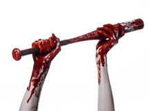 Bloody hand holding a baseball bat, a bloody baseball bat, bat, blood sport, killer, zombies, halloween theme, isolated, white bac Royalty Free Stock Image