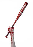 Bloody hand holding a baseball bat, a bloody baseball bat, bat, blood sport, killer, zombies, halloween theme, isolated, white bac Stock Photo