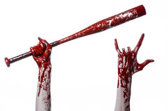 Bloody hand holding a baseball bat, a bloody baseball bat, bat, blood sport, killer, zombies, halloween theme, isolated, white bac Royalty Free Stock Photography