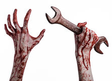 Bloody hand holding a big wrench, bloody wrench, big key, bloody theme, halloween theme, crazy mechanic, white background Royalty Free Stock Images