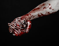 Bloody hand holding chain, bloody chain, halloween theme, black background, isolated Royalty Free Stock Images