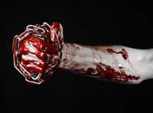 Bloody hand holding chain, bloody chain, halloween theme, black background, isolated Stock Image