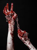 Bloody hand holding chain, bloody chain, halloween theme, black background, isolated Royalty Free Stock Image