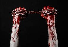 Bloody hand holding chain, bloody chain, halloween theme, black background, isolated Royalty Free Stock Photos