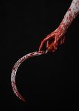 Bloody hand holding a sickle, sickle bloody, bloody scythe, bloody theme, halloween theme, black background, isolated Royalty Free Stock Images