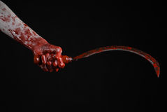 Bloody hand holding a sickle, sickle bloody, bloody scythe, bloody theme, halloween theme, black background, isolated Stock Photography