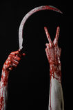 Bloody hand holding a sickle, sickle bloody, bloody scythe, bloody theme, halloween theme, black background, isolated Royalty Free Stock Photo