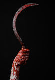 Bloody hand holding a sickle, sickle bloody, bloody scythe, bloody theme, halloween theme, black background, isolated Royalty Free Stock Photos