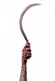 Bloody hand holding a sickle, sickle bloody, bloody scythe, bloody theme, halloween theme, white background, isolated Stock Photography