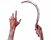 Bloody hand holding a sickle, sickle bloody, bloody scythe, bloody theme, halloween theme, white background, isolated Stock Photos