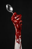 Bloody hand holding a spoon, fork, halloween theme, bloody spoon, fork, black background, isolated Royalty Free Stock Photography