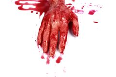 Bloody hand making. A bloody hand making a fist with blood dripping down isolated on white Stock Photo