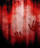 Bloody hand print on wall Stock Images
