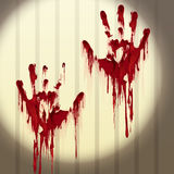Bloody hand prints on a wall Stock Photography
