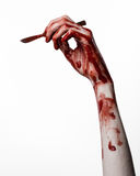 Bloody hand with a scalpel on a white background, isolated, zombie, demon, maniac, isolated. Studio Stock Images