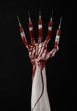 Bloody hand with syringe on the fingers, toes syringes, hand syringes, horrible bloody hand, halloween theme, zombie doctor, black Stock Photo