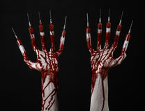 Bloody hand with syringe on the fingers, toes syringes, hand syringes, horrible bloody hand, halloween theme, zombie doctor, black Royalty Free Stock Image