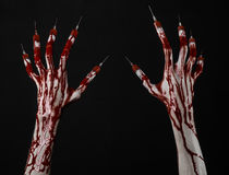Bloody hand with syringe on the fingers, toes syringes, hand syringes, horrible bloody hand, halloween theme, zombie doctor, black Stock Image