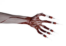 Bloody hand with syringe on the fingers, toes syringes, hand syringes, horrible bloody hand, halloween theme, zombie doctor, white Royalty Free Stock Photos