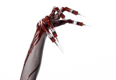 Bloody hand with syringe on the fingers, toes syringes, hand syringes, horrible bloody hand, halloween theme, zombie doctor, white. Background, isolated studio Royalty Free Stock Image