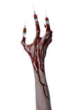 Bloody hand with syringe on the fingers, toes syringes, hand syringes, horrible bloody hand, halloween theme, zombie doctor, white Royalty Free Stock Photography