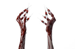 Bloody hand with syringe on the fingers, toes syringes, hand syringes, horrible bloody hand, halloween theme, zombie doctor, white Stock Photos