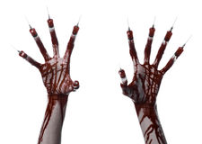 Bloody hand with syringe on the fingers, toes syringes, hand syringes, horrible bloody hand, halloween theme, zombie doctor, white Royalty Free Stock Photo