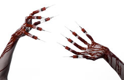 Bloody hand with syringe on the fingers, toes syringes, hand syringes, horrible bloody hand, halloween theme, zombie doctor, white Stock Photography