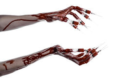 Bloody hand with syringe on the fingers, toes syringes, hand syringes, horrible bloody hand, halloween theme, zombie doctor, white. Background, isolated studio Royalty Free Stock Photos