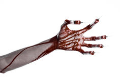 Bloody hand with syringe on the fingers, toes syringes, hand syringes, horrible bloody hand, halloween theme, zombie doctor, white. Background, isolated studio Stock Image