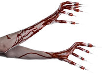 Bloody hand with syringe on the fingers, toes syringes, hand syringes, horrible bloody hand, halloween theme, zombie doctor, white. Background, isolated studio Royalty Free Stock Images