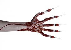 Bloody hand with syringe on the fingers, toes syringes, hand syringes, horrible bloody hand, halloween theme, zombie doctor, white Stock Image
