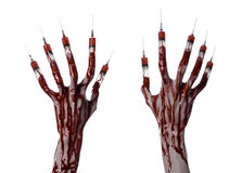Bloody hand with syringe on the fingers, toes syringes, hand syringes, horrible bloody hand, halloween theme, zombie doctor, white Stock Images