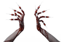 Bloody hand with syringe on the fingers, toes syringes, hand syringes, horrible bloody hand, halloween theme, zombie doctor, white. Background, isolated studio Stock Photos